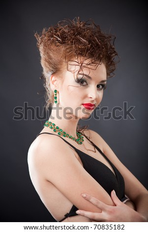 Portrait of elegant woman with earrings and necklace, portrait shot