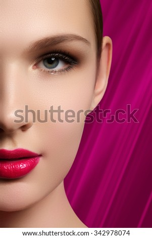 Portrait of elegant woman with pink lips. Beautiful young model with pink lips. Sexy woman model with bright pink lips makeup, and healthy shiny skin. Evening glamour style, fashion make-up - stock photo