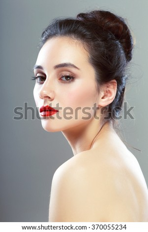 Portrait of elegant woman with red lips - stock photo