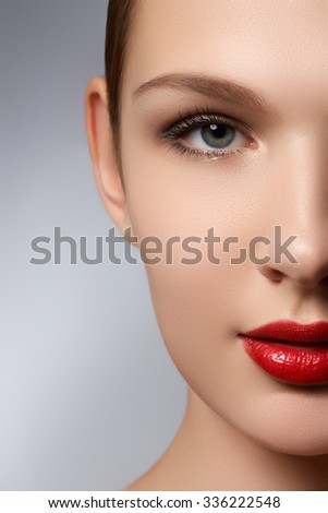 Portrait of elegant woman with red lips. Beautiful young model with red lips. Sexy woman model with bright red lips makeup, and healthy shiny skin. Evening glamour style, fashion make-up - stock photo