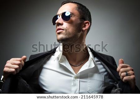 Portrait of elegant young handsome man. Studio fashion portrait. - stock photo