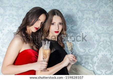 Portrait of elegant young womans with a champagne glasses at celebration