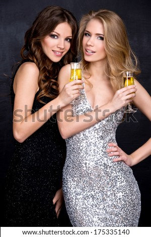 Portrait of elegant young womans with a champagne glasses at celebration - stock photo