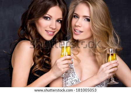 Portrait of elegant young women with a champagne glasses at celebration