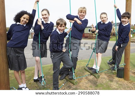 Portrait Of Elementary School Pupils On Climbing Equipment - stock photo