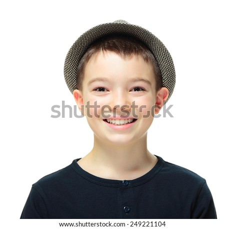 Portrait of eleven years old boy clothing a hat on white background  - stock photo