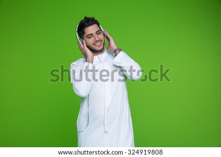 Portrait of Emirati man listening music on headphones