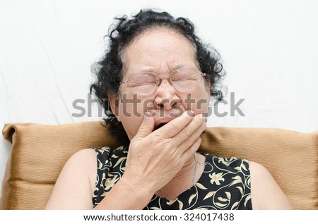 Portrait of emotion asian senior woman with yawn expression  - stock photo