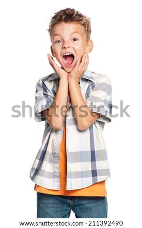 Portrait of emotional boy isolated on white background - stock photo