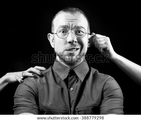 portrait of emotional young man and lot of hands