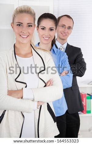 Portrait of employees in an office - woman and man.