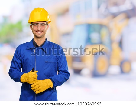 Portrait Of Engineer Holding Plier, Outdoors