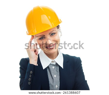 Portrait of engineer woman with protective helmet, isolated on white background.Close-up of female contractor or entrepreneur, studio-shot