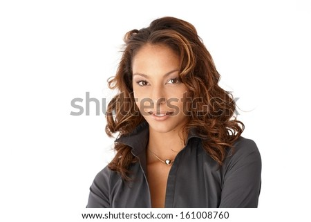 Portrait of ethnic woman smiling, looking at camera.