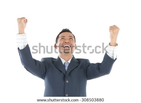 Portrait of excited asian indonesian businessman celebrating success over white background - stock photo