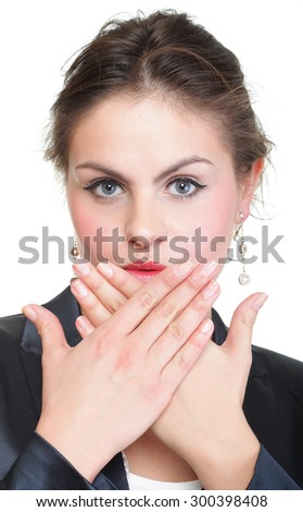 portrait of excited business woman covering her mouth by the hand, over white background - stock photo