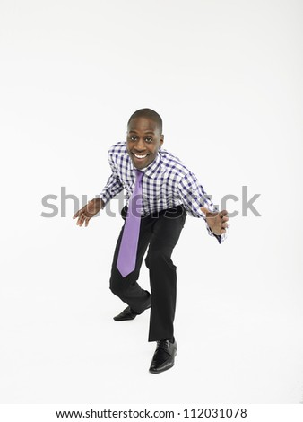 Portrait of excited businessman gesturing over white background - stock photo