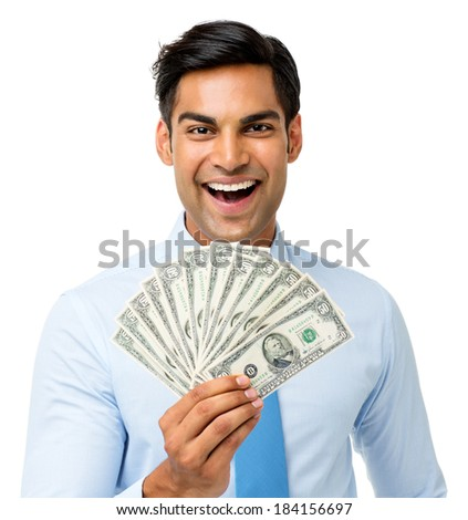 Portrait of excited businessman holding fanned out fifty dollar notes against white background. Horizontal shot.