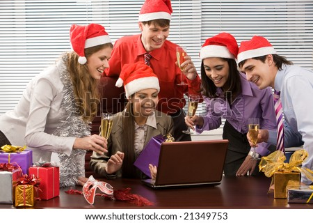 Portrait of excited co-workers gathered together in office and having corporate party - stock photo