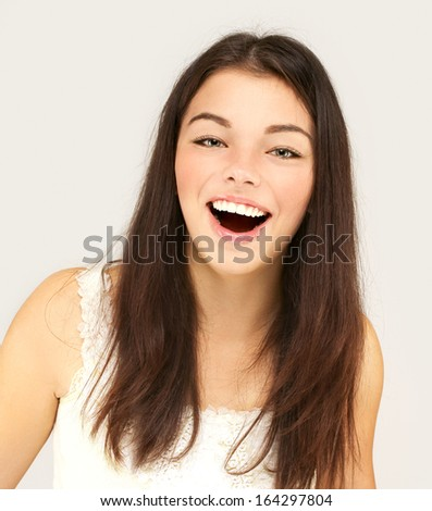 Portrait of excited happy girl - stock photo