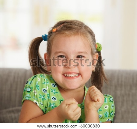 Portrait of excited little girl (3-4 years) at home.? - stock photo