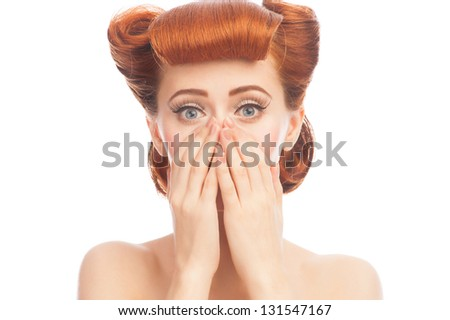 Portrait of excited pinup woman with hairstyle and makeup covering her mouth. Isolated on white background