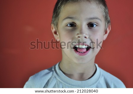 Portrait of excited small boy. Hard light. - stock photo
