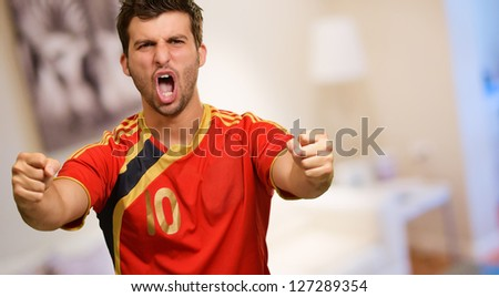 Portrait Of Excited Sportsman, Indoors