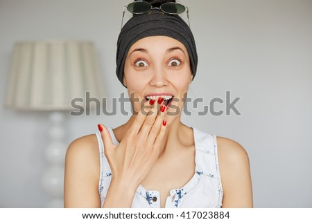 Portrait of excited young female saying yes to her boyfriend's proposal, can't believe she is going to get married soon, covering her open mouth in amazement. Human face expressions and emotions  - stock photo