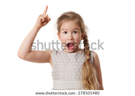 Portrait of excited young girl pointing finger up over white background and looking at camera - stock photo