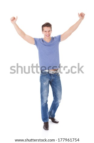 Portrait Of Excited Young Man With Hand Raised Over White Background - stock photo