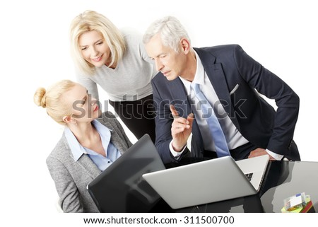 Portrait of executive sales man showing his idea and presenting his financial plan to businesswomen on laptop. Group of business people consulting. Isolated on white background.  - stock photo