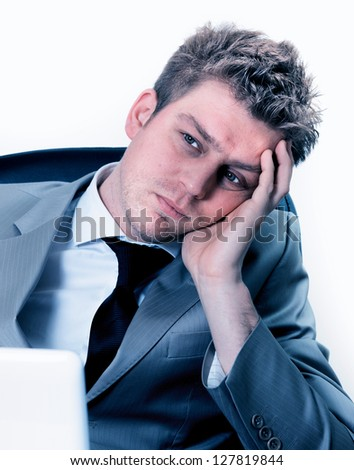 Portrait of  exhausted businessman at the office - stock photo