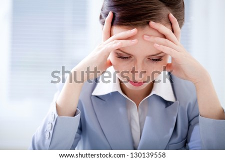 Portrait of exhausted businesswoman in office - stock photo