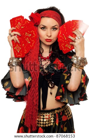 Portrait of expressive gypsy woman with cards. Isolated - stock photo