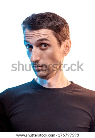 Portrait of Expressive suspecting man - stock photo