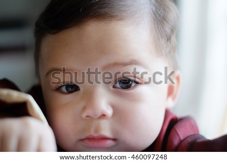 Portrait of face toddler baby boy wearing chinese dress.