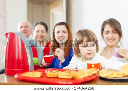 Portrait of   family communicate around tea table at home