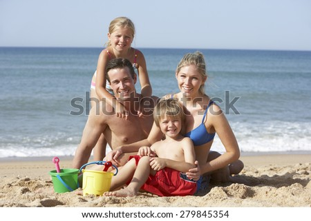 Portrait Of Family Enjoying Beach Holiday - stock photo