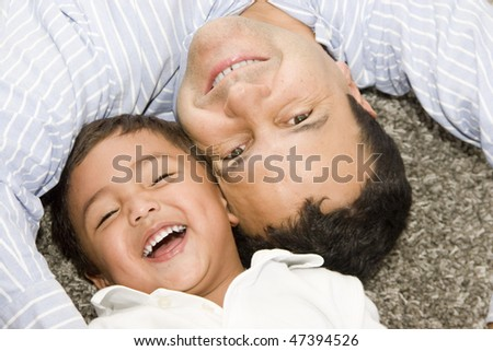 Portrait of family, father and son enjoying at home - stock photo