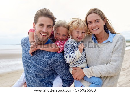 Portrait Of Family Having Fun On Beach Together - stock photo