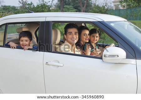 Portrait of family in car - stock photo