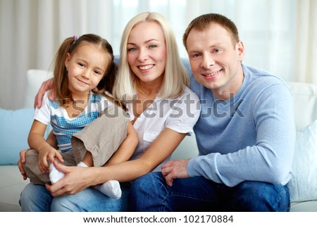 Portrait of family in casual clothes resting at home - stock photo