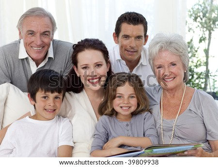 Portrait of family looking at a photograph album at home