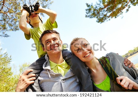 Portrait of family of travelers on summer vacation