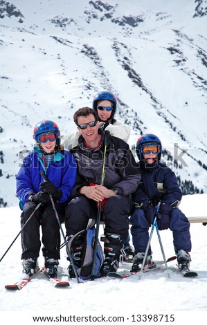 portrait of family on ski holiday - stock photo