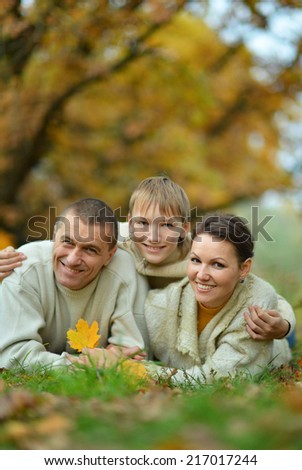 Portrait of family relaxing in autumn park