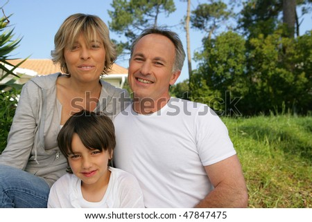 Portrait of family sitting in a garden