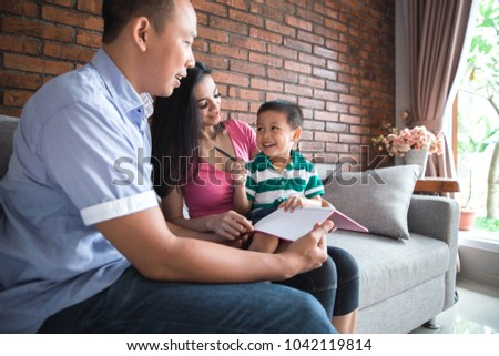 Portrait of family spending time together in the living room