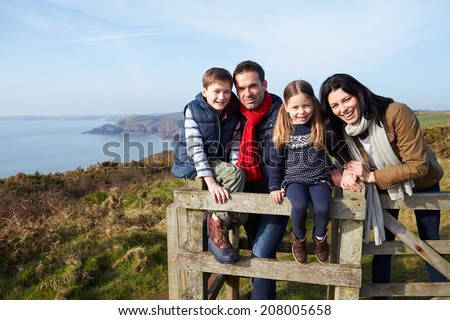 Portrait Of Family Walking Along Coastal Path - stock photo